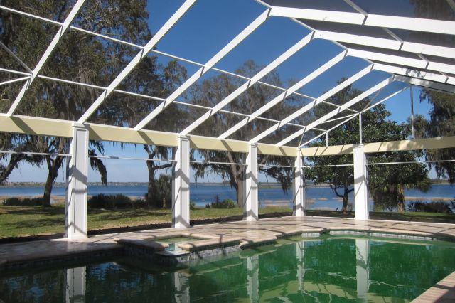 Daytona beach pool screen enclosure and patio enclosures for Cost to build a lanai